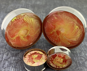 Pair of Orange Sunburst Swirl Resin Plugs